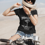 joshua-tree-service-t-shirt-a-woman-on-a-motorcycle-in-the-desert-the-secret-tours-joshua-tree-national-park-adventure-camping-climbing-hiking-black